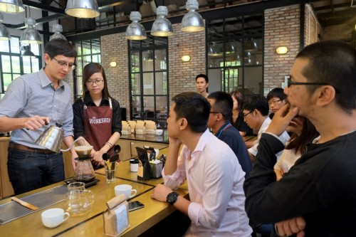 Will Frith (L) runs an impromptu barista training at Workshop, the newest and most prominent coffee-bar in Ho Chi Minh City